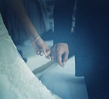 Wedding couple bride groom holding hands analogue film photo by edwardolive