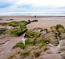 single girl walking near unusual mud banks by morrbyte