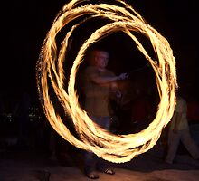 Stone Circle - Fire Twirling by Roger Barnes