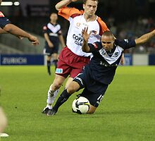 Archie Thompson gets pushed down by Clinton Plowman