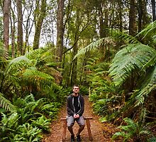 Person at peace in tropical jungle in Australia by Ryan Jorgensen