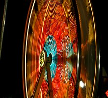 The Wheels at the Fair Go Round and Round by Ken Fortie