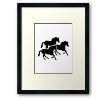 Running black horses Framed Print