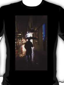 Man walking in street at night in rain color 35mm analogue photojournalism portrait photograph T-Shirt
