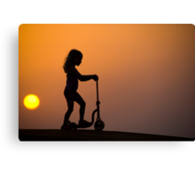 Child on a scooter Canvas Print