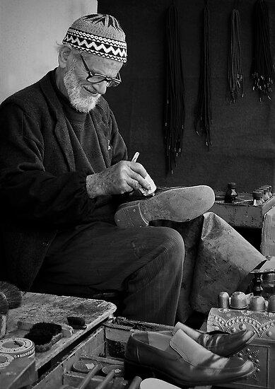 Street Cobbler at Work by Peter Evans