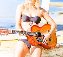 Young Attractive Blonde Woman Playing Guitar by Ryan Jorgensen