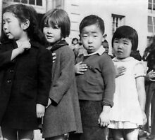 Children at the Weill public school in San Francisco pledge allegiance to the American flag in April 1942, prior to the internment of Japanese Americans. by Adam Asar