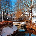 Bridge and river in winter scenery | architectural photography by Patrick Jobst