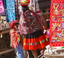 Peruvian Indian woman looking at colorful textiles by cascoly