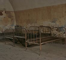 beds in a  collective cell in the concentration camp in Terezin by danapace