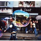 Bubble in London street by Adam Irving