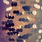 Abstract bokeh glittering light effects background by mikath