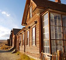 Row of ghost town buildings by N2Digital