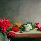 roses on table by Demetrios Vlachos