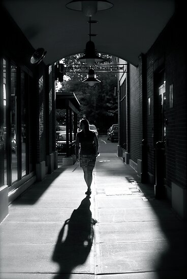 Woman walking in the shadows by AlphaMale912