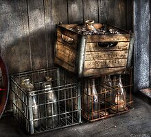 Bottles in Boxes by Mike  Savad
