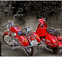 Two red bikes by Maistora