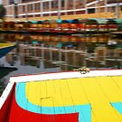 Bow of  brightly colored boat by cascoly