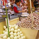 Woman selling garlic and onions by cascoly