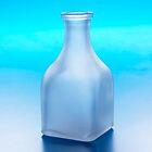 white bottle on blue background by brunogori