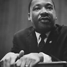 Martin Luther King in 1964 leaning on a lectern by Adam Asar
