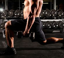 Guy doing lunge with weight by Mark McElroy