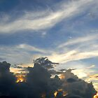 Sunset over dark clouds by bfokke