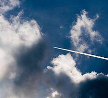 Plane splitting the noon sky by Golden Richard
