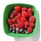 Raspberries and Blueberries in Green Bowl  by jojobob