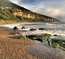 rocks on coalcliff beach by puzzleman