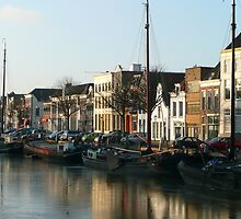 A winter scene at the harbour of Zwolle by jchanders