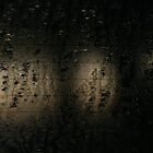 Raindrops on window by jukeboxphoto