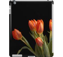Orange tulips against black background iPad Case/Skin