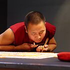 Tibetan monk creating sand mandala by May Lattanzio