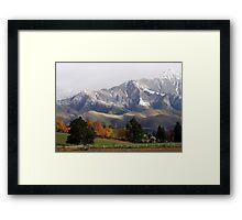 Mountain Ridge Against A Snow Laden Sky Framed Print