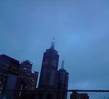 rooftop cinema, small city, blue light by Tatterhood