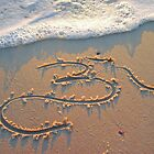 Om in the sand by Maya -