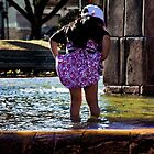 Splashing In San Blas Fountain by Al Bourassa