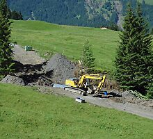 Bulldozing a new path on a Swiss mountain side by ashishagarwal74