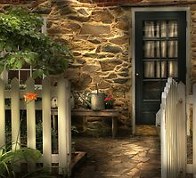 Side entrance of a small cottage by Mike  Savad