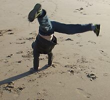 Cartwheels in the Sand by nikki harrison
