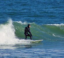 Surfing at Cape Hatteras North Carolina in the Winter by paulboggs