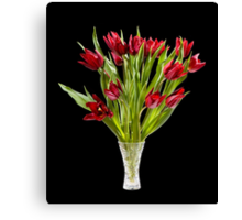 Red cut tulips bouquet in glass Canvas Print