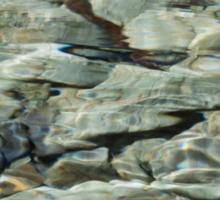 water over stones Sticker