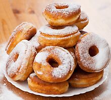 donuts with holes and powdered sugar  by Arletta Cwalina