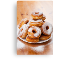 donuts with holes and powdered sugar  Canvas Print