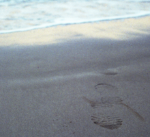 Foot prints at dawn on empty sandy beach sea side Hasselblad square medium format film analogue photograph Sticker