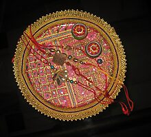 A bowl of rakhis (from the Indian Hindu festival of Rakhi) in a decorated dish by ashishagarwal74