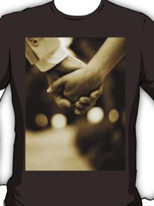 Bride and groom holding hands sepia toned black and white silver gelatin 35mm film analog wedding photograph T-Shirt